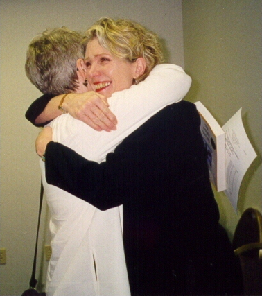 Author Carol Schaefer embraces unidentified conference attendee