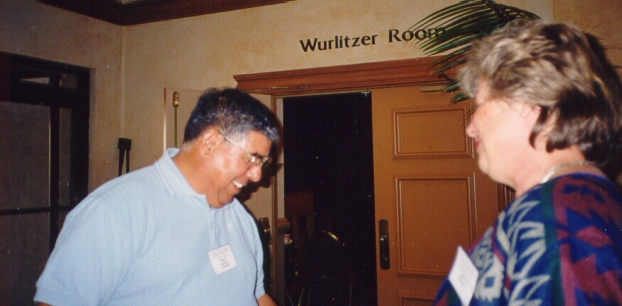 Robert Martinez sells raffle tickets to an unidentified conference attendee